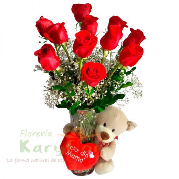 Arreglo elaborado en florero de vidrio con una docena de rosas importadas, fino follaje. Incluye tarjeta de dedicatoria y osito cariñoso( consultar modelos de peluches). Pueden adicionar Chocolates y más, ingresando a la opción REGALOS en la parte superior de la Pág. web.