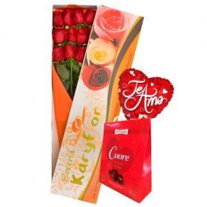 Caja de 12 rosas, globo Nº9 (modelo a escoger) + chocolate sujeto a stock (Bouquet o Cuore). Incluye tarjeta para para dedicatoria y preservante de flores. Pueden adicionar Chocolates y más, ingresando a la opción REGALOS en la parte superior de la Pág. web