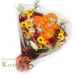 Ramo primaveral con flores variadas, incluye tarjeta para dedicatoria y lazo en cinta satinada.